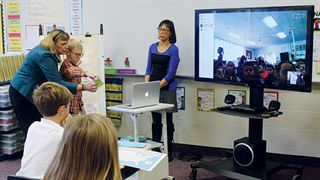 Ada Christian third grade connecting to another class using Skype