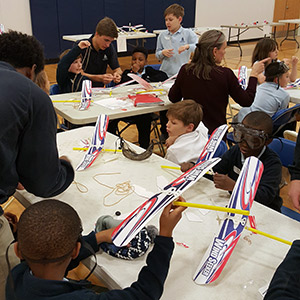 Annapolis students working on airplanes