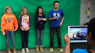 Lansing Christian students using a green screen