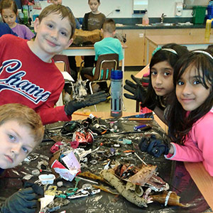 Surrey Christian students examining trash collected