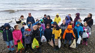 Surrey Christian School cleaning up garbage from tide pools