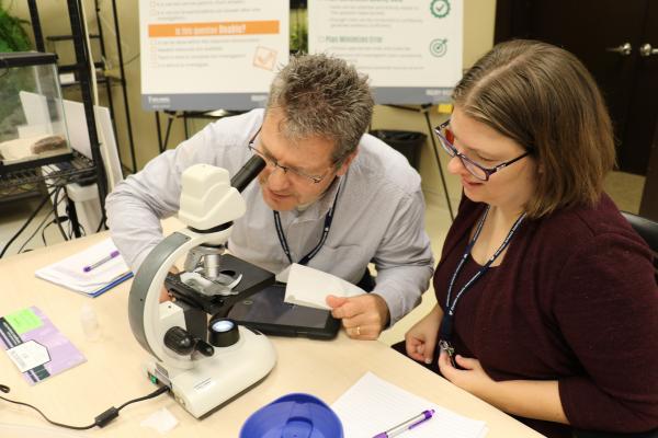 CSESA cohort 3 teachers using microscope