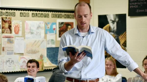Ben Tameling from Grandville's Calvin Christian High School reads one of the Immerse books to his class